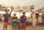 Billy's Children in front of daddy's airplane